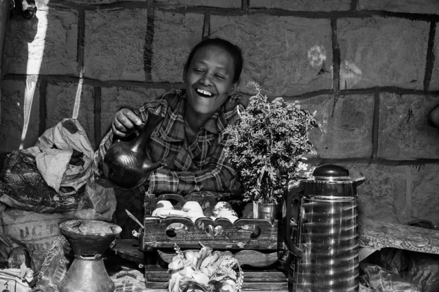 woman smiling at a stall